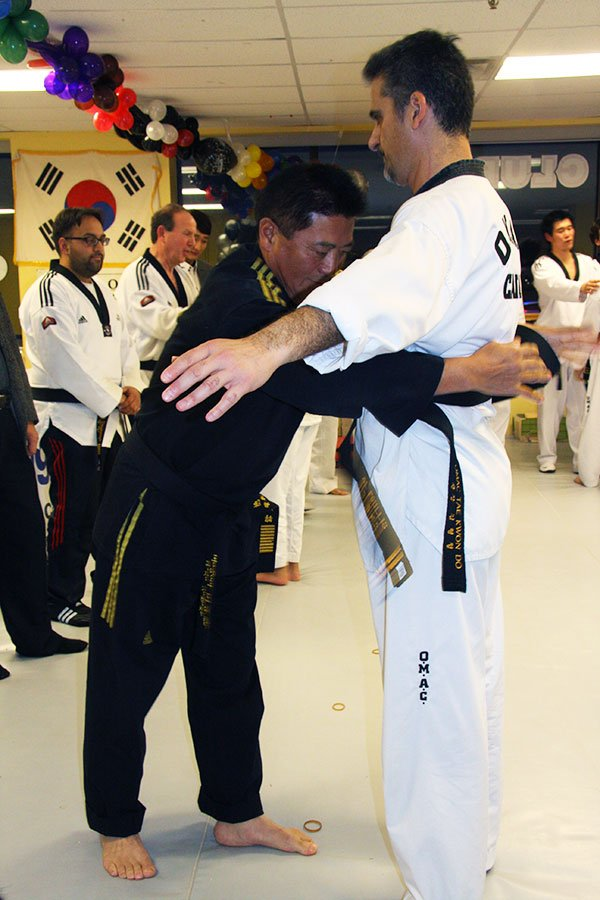 Grandmaster Kim black belt 2nd dan
